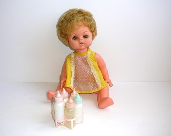Uneeda DOLL 1960s Plastic Doll with Bottles