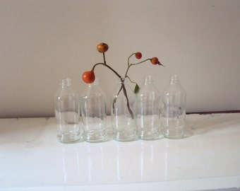 Five upcycled industrial, apothecary bottles. Great for weddings / restaurant decor.