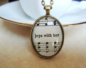 Joys with her sheet music oval pendant, vintage sheet music pendant necklace