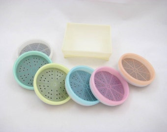 Vintage Tupperware Wagon Wheel Coasters in Pastel Colors - Complete Set with Holder / Caddy