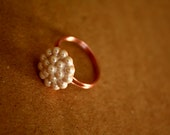white BUTTON FLOWER RING on light pink band