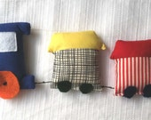 Fabric soft train toy in primary and secondary colors