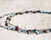 3 Tier Necklace With Koa Wood, Blue Glass And Black Hemp.