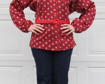 1970s red shirt with white and blue flowers, poet sleeves