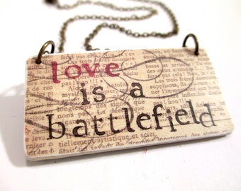 80s inspired necklace pat benetar love is a battlefield hand stamped pendant paper necklace