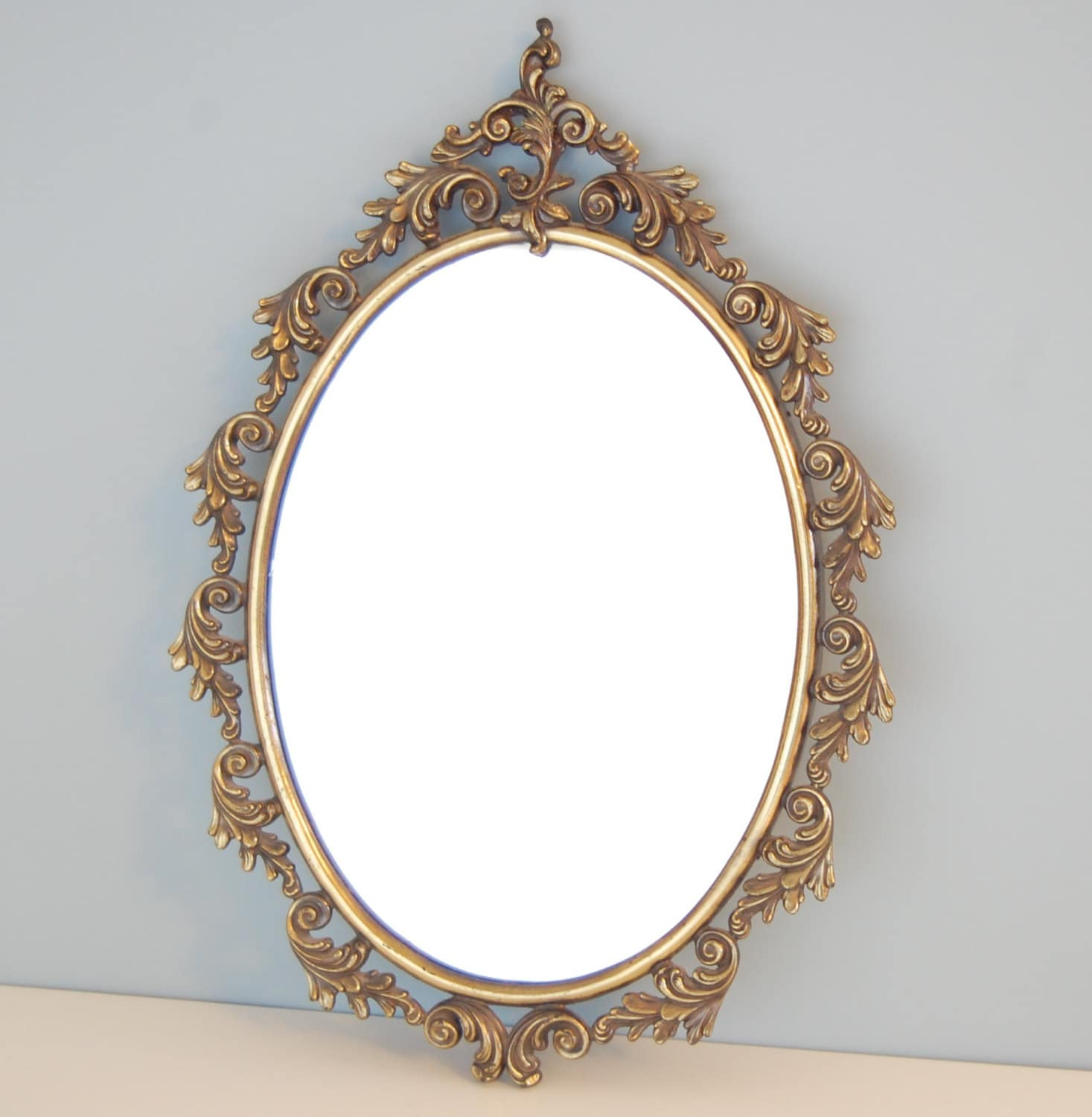 Vintage gold ornate oval wall mirror for Vintage mirror