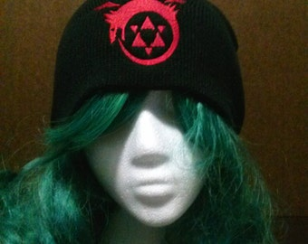 Anime and manga inspired Full Metal Alchemist homunculus symbol ouroboros beanie skull cap