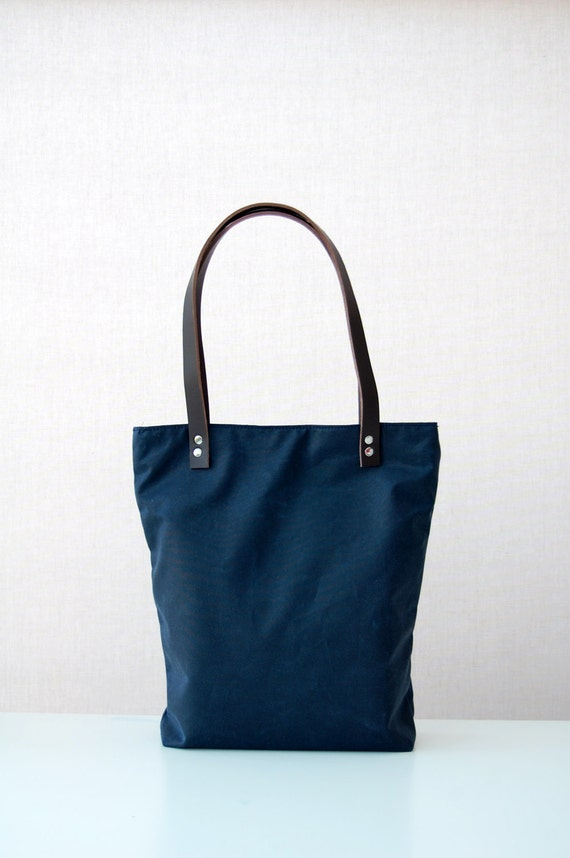 Navy blue waxed canvas tote bag with leather handles