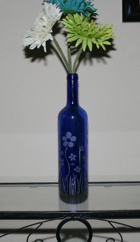 Blue upcycled etched flowers wine bottle vase centerpiece for Wine bottle flower vase