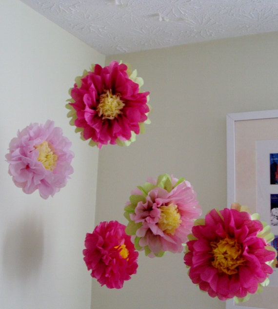 tissue paper pom poms tutorial These tissue paper pom poms are inexpensive, but look impressive when hanging in groups from chandeliers or the ceiling.