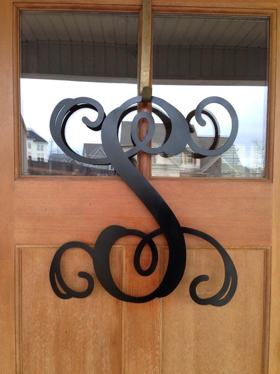 metal monogram door hanger monogrammed wreath by southerngreeters