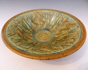 Textured terracotta bowl with California dreaming glaze