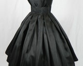 A Gorgeous Black Shantung 50s cocktail dress, fully lined and shown wearing a petticoat
