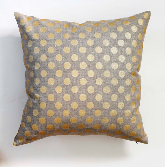 gray and gold pillows