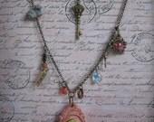 Handpainted Alice in Wonderland Cameo Necklace Cheshire cat Jabberwocky Swarovski crystals