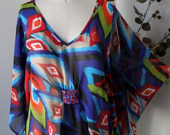 Exotic embellished Plus Size Poncho welcoming Spring in 1xl,2xl,3xl sizes.