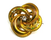 An Edwardian Lovers Knot Brooch Yellow Gold Fill with Paste Rhinestone and Enamel Flowers Flower Motif CIRCA 1910