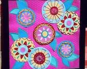 vibrant retro feel hand sewn framed paper flowers