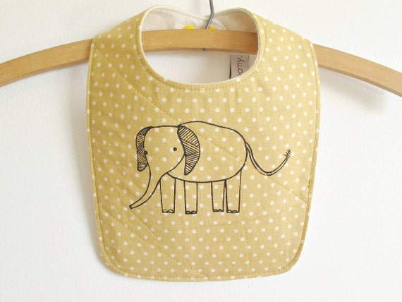 baby bib with polka dots and elephant print.