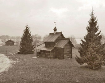 Wooden Chapel. Ancient Architecture. Onion Dome Church. Pine trees. Sepia. Novgorod, Russia.