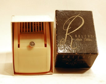 vintage Rolcut Hair Cutter with blades and original box and instructions