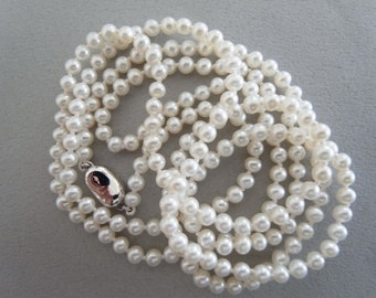 Freshwater white pearl necklace.