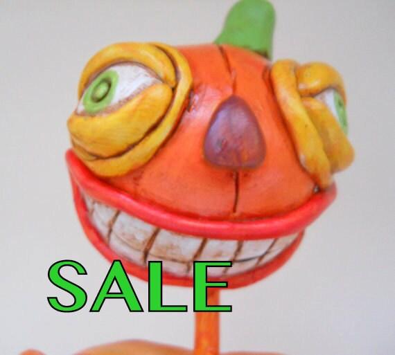 Halloween Pumpkin Man in White Black Orange Purple and Green with a Candy Corn Bucket