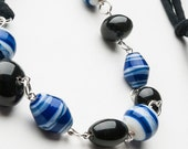 chunky bead necklace, black and blue beads with jersey tie, reserved for Carla