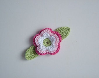 Crocheted  flower with two leaves