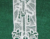 Machine Lace Bookmark, Cross with shroud and lilies at the bottom.