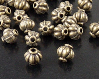 Bead Spacer 50 Antique Bronze Corrugated Round 6mm x 5.4mm NF (1060spa06z1)