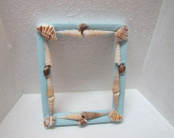Vintage frame decorated with shells and painted blue