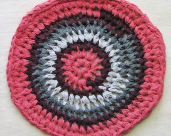 "Round trivet, crocheted from eco-friendly cotton t-shirt yarn, large 11"" diameter, sun-washed coral red and gray"