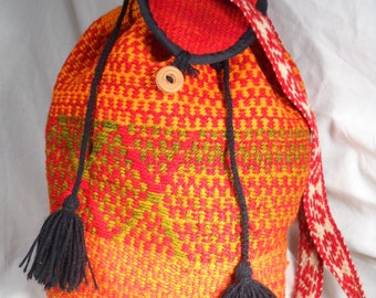 PERUVIAN WOOL POUCH with shoulder strap and drawstring closure.