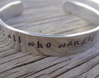 Aluminum cuff bracelet hand stamped with -not all who wander are lost- ready to ship gift for her graduation gift