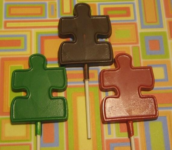 One dozen large puzzle piece lollipop suckers