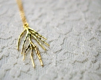 Branch necklace. Oxidized gold plated brass charm on gold plated chain.