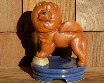 Sculpture of a Chow on an Chinese pedestal