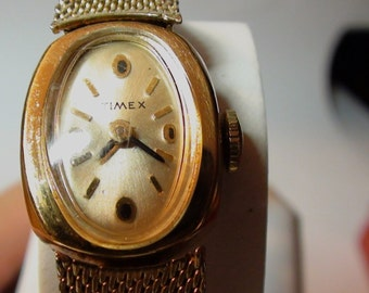 Timex  Watch Bracelet Wind Up   Mechanical  and is Working gold filled  Antique 17 jewels working  On SaLe Now