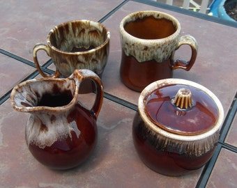 Group of Brown Drip  Coffee Cups With Creamer And Sugar