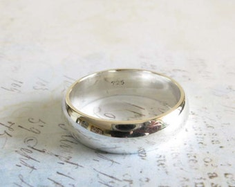 Sterling silver wedding ring.  Artisan handmade 6mm domed band.  Smooth polished finished. Classic jewelry. His or hers.