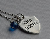Police shield necklace