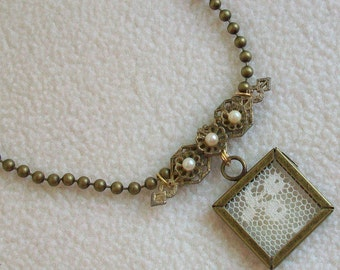 Assemblage necklace  Vintage ingredients  Lace snippet  Pearl brooch  Bronze findings  Boho vibe