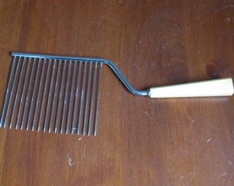 Antique cake tool with a bakelite handle