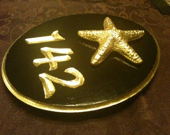 Gold leaf number sign with starfish or shell