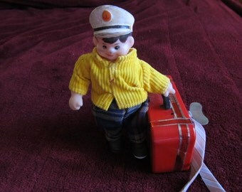 Vintage Rubber man with red suitcase windup toy
