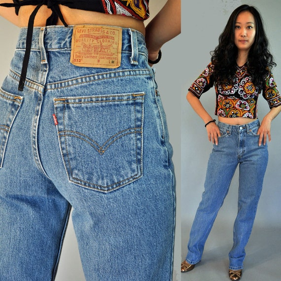 80s Vintage Levis / high waisted jeans / Distressed Faded