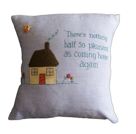 Home quote cushion pillow, applique and embroidery on lilac cotton.