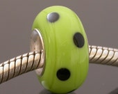 Glass Charm Bead for Bracelets, European style charm bead, green with black polka dots, artisan made lampwork glass bead with silver core