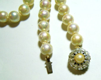 vintage off white pearlish hand knotted single strand necklace with rhinestone clasp